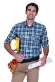 Męski budowniczy z planami Zdjęcia Royalty Free