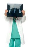 Męski chirurg target1257_0_ jego twarz z promieniowania rentgenowskiego raportem Zdjęcie Royalty Free