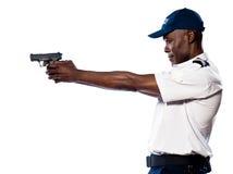 Męski funkcjonariusz policji celowania pistolet Fotografia Stock