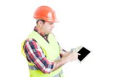 Męski konstruktor wskazuje palec na pastylce Zdjęcie Royalty Free