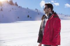 Męski portret na niebieskiego nieba tle na zimie Zdjęcie Royalty Free