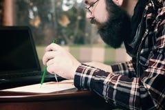 Męski praca notatnik brodaty Obraz Royalty Free