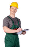 Męski pracownik budowlany z notatkami Obrazy Royalty Free