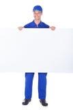 Męski pracownika mienia pustego miejsca plakat Zdjęcie Stock