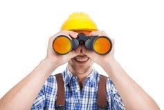 Męski repairman patrzeje przez lornetek Fotografia Stock