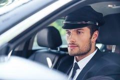Męski szofera obsiadanie w samochodzie Obrazy Royalty Free