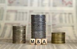 M&A som är podestal från mynt royaltyfria foton