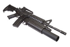 An M4A1 SOPMOD carbine equipped with an M203 grenade launcher Stock Photos