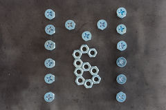 M6 symbol. Made of nuts and bolts Royalty Free Stock Photo
