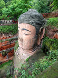 The 71m tall Giant Buddha (Dafo), carved out of the mountain in. The 8th century CE in Leshan, Sichuan province, China Royalty Free Stock Photo