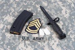 M-16 tijdschrift met munitie en bedelaars Stock Foto
