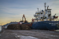 M/V Hagland Captain  unloads timber Stock Photo