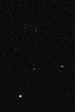 M51 Whirlpool Galaxy and Alkaid. M51 Whirlpool Galaxy as seen by a 200mm lens, to the right of the star Alkaid in Ursa Major royalty free stock photos