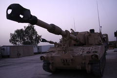 M109 155 mm Self-propelled Howitzer. A wide angle image of a Paladin M109 Howitzer on a forward operating base in Iraq at dusk Stock Images