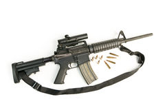 M16 Style Assault Rifle with Bullets on White Stock Images