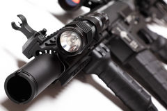 M4A1 carbine with tactical flashlight. M4A1 carbine with RIS/RAS forearm and tactical flashlight. Shallow DOF royalty free stock image