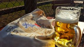 Maß beer. A Maß of beer in the Beergarden Stock Image