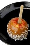 Maçã de caramelo com cobertura do coco Imagem de Stock Royalty Free
