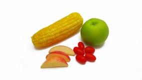 Maçã do milho, dos tomates, a vermelha e a verde no fundo branco Fotografia de Stock Royalty Free