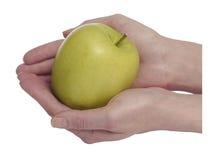 Maçã verde nas mãos imagem de stock royalty free