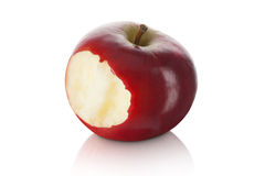 Maçã vermelha doce e fresca com uma mordida removida Imagem de Stock Royalty Free