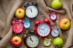 Maçãs e despertadores Imagem de Stock Royalty Free