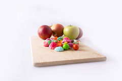 Maçãs e doces Imagens de Stock