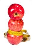 Maçãs e fita de medição Foto de Stock Royalty Free