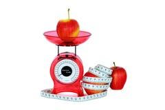 Maçãs, escalas e medida Fotografia de Stock
