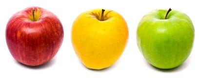 Maçãs frescas vermelhas, amarelas e verdes Imagens de Stock Royalty Free