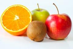 Maçãs, quivi e laranja Fotos de Stock