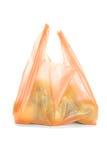 Maçãs verdes no saco de plástico fotografia de stock royalty free
