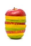 Maçãs vermelhas, amarelas e verdes cortadas Imagem de Stock
