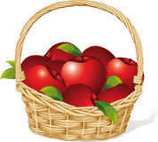 Maçãs vermelhas em uma cesta isolada no branco Imagens de Stock