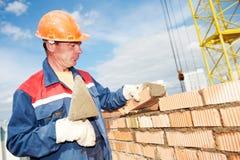 Maçon d'ouvrier de maçon de construction photographie stock libre de droits