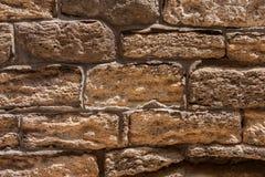 Maçonnerie d'un mur en pierre antique érodé Photo stock