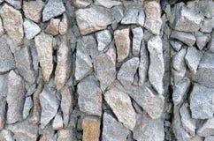 Maçonnerie en pierre rugueuse grise sur la texture de façade photographie stock