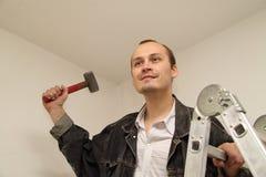 Maître avec un marteau Photographie stock libre de droits