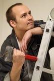 Maître avec un marteau Photographie stock