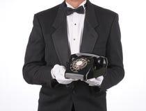 Maître d'hôtel avec le téléphone Photo stock
