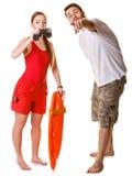 Maître nageurs avec la balise et les jumelles de délivrance Images libres de droits