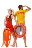 Maître nageurs avec la bouée de sauvetage de balise de délivrance et d'anneau Photos stock
