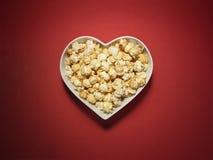 Maïs éclaté de cinéma de coeur d'amour - image courante Photographie stock