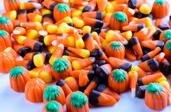 Maïs, bonbons au maïs, et fond de potirons Photo stock