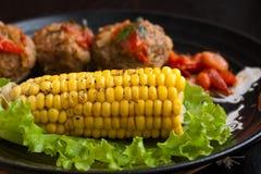 Maïs et boulettes de viande Photographie stock libre de droits