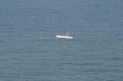 Mała łódka w oceanie Obraz Royalty Free