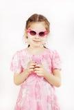 Mała ładna dziewczyna jest ubranym piękne menchie ubiera z zabawkarską wiszącą ozdobą Obraz Royalty Free