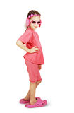 Mała śliczna dziewczyna jest ubranym menchii ubrania i dużych plażowych kapcie Obrazy Stock