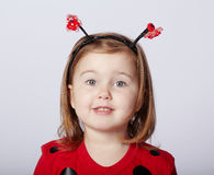 Mała śmieszna dziewczyna w biedronka kostiumu Fotografia Stock