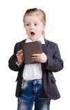 Mała biznesowa dziewczyna z pastylką zdjęcie stock